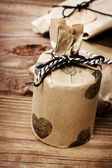 Holiday presents wraped in a rustic earthy style — Stok fotoğraf