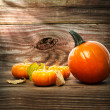 Squashes and pumpkins on wooden table background — Stock Photo #32331423