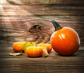 Squashes and pumpkins on wooden table background — ストック写真