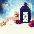 Christmas lantern with ornaments in the snow — Stock Photo #32774577