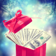 Stock Photo: Hundred dollar bills in red present box