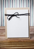 Hand crafted blank card on a striped background — Stock Photo
