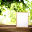 Greeting card on the wooden table — Stock Photo