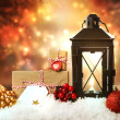 Christmas lantern with ornaments and presents  — Stock Photo