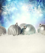 Christmas baubles on the snow — Stock Photo