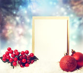 Christmas card with ornaments — Stock Photo