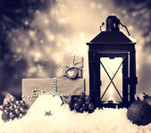 Christmas lantern with ornaments and presents — Stok fotoğraf