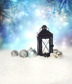 Christmas lantern with ornaments — Stock Photo