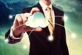 Businesman holding cloud computing icon — Stock Photo