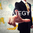 Businessman pointing STRATEGY — Stock Photo