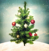 Decorated Christmas tree on hilltop — Stock Photo