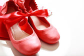 Red shoes with ribbon — Stock Photo