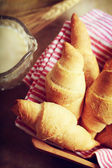 Croissant with milk and wheat — Stok fotoğraf