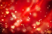 Golden hearts on red background — Stok fotoğraf