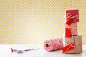 Handmade small boxes with scissors and spool — Stock Photo
