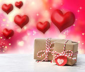 Handmade gift boxes with red hearts — Stock Photo