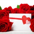 Hearts greeting card with beautiful red roses — Stock Photo