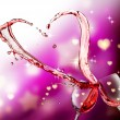 Heart splash from two glasses of red wine — Stock Photo #38349029