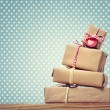 Stock Photo: Handmade gift boxes over polka dots background