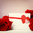 Hearts greeting card with red roses — Stock Photo #38349057