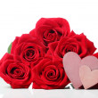 Heart tags with red roses — Stock Photo