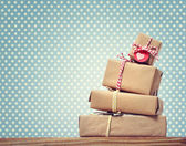 Handmade gift boxes over polka dots background — Stock Photo