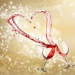 Heart splash from two glasses of red wine — Stock Photo #38728665