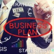 Businessman drawing business plan concepts — Stock Photo