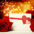 Hearts greeting card with red roses — Stock Photo