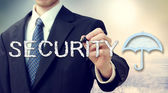 Security umbrella with businessman — Foto de Stock