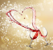 Heart splash from two glasses of red wine — Stock Photo