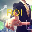 Stock Photo: Businessman touching ROI (return on investment)