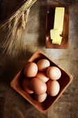 Eggs with butter and wheat — Stockfoto