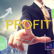 Business man pointing PROFIT — Stock Photo