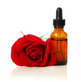 Dropper bottle with red rose — Foto de Stock