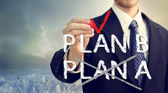 Businessman checking PLAN B — Foto de Stock