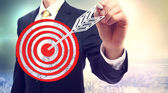 Business man drawing target — Stock Photo