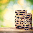 Stock Photo: Mustache pattered gift boxes