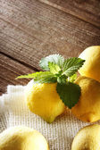 Lemons on a rustic wooden table — Stok fotoğraf