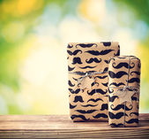 Mustache pattered gift boxes — Stock Photo