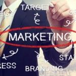 Businessman drawing marketing concept diagram — Stock Photo