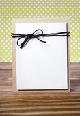 Handmade card on wooden table — Stock Photo