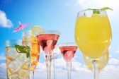 Assortment of drinks over blue sky — Stockfoto
