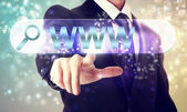 Businessman pressing WWW button — Stockfoto