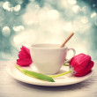 Stock Photo: Coffee cup with red tulips
