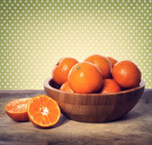 Tangerines in wooden bowl  — Stock fotografie