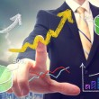 Businessman pointing at rising arrows — Stock Photo
