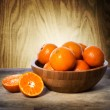 Stock Photo: Tangerines in wooden bowl
