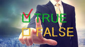 Businessman pointing TRUE — Stock Photo