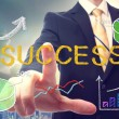 Bussinessman pointing at SUCCESS — Stock Photo #42819701